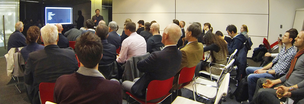 Photograph of audience listening to SDS talk