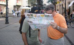 Lost people looking at map