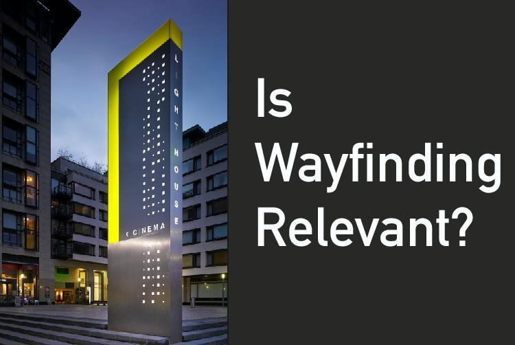 "A picture of waygfinding signage captioned with the question ""Is wayfinding relevant?"""