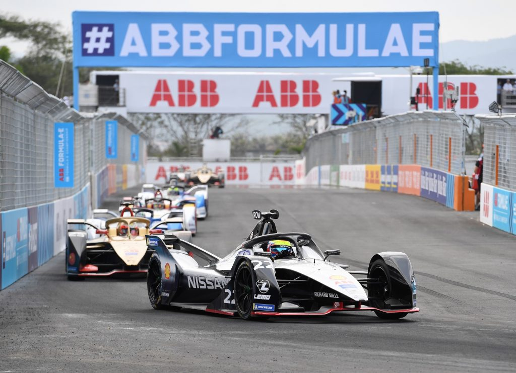 View of E-Prix racing with trackside branding banners