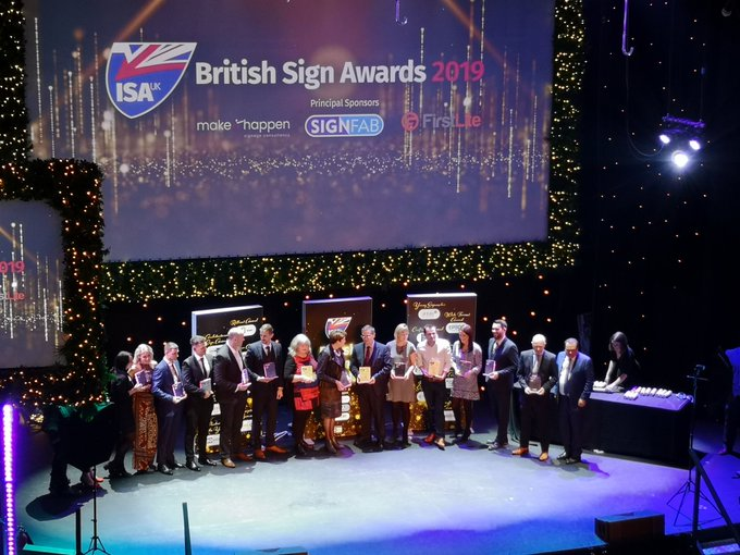 View of the British Sign Awards 2019 winners receiving their trophies