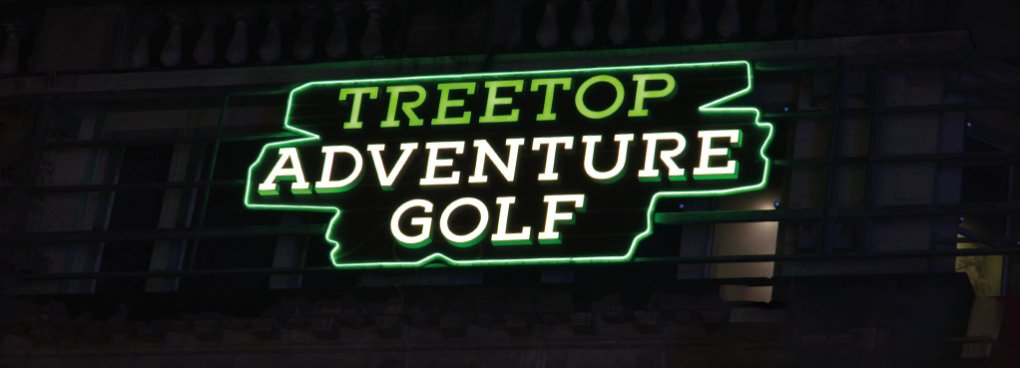 A night-time illuminated view of the signage for Treetop Advnture Golf
