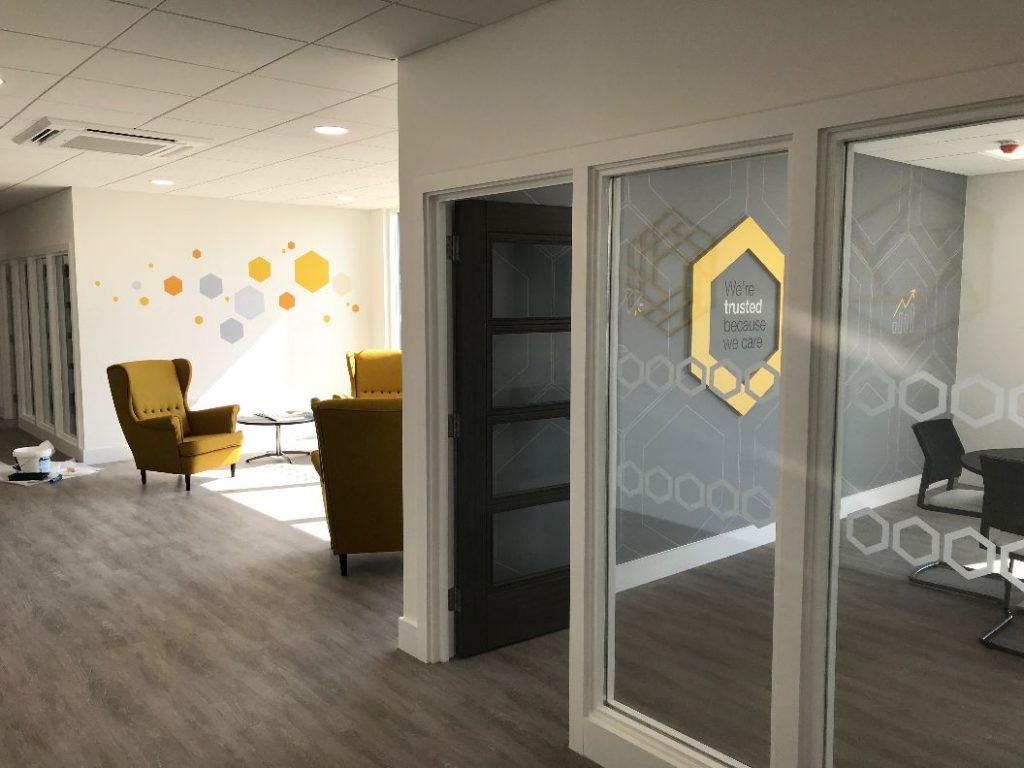Telford Mann branding graphics hexagons used within the office space