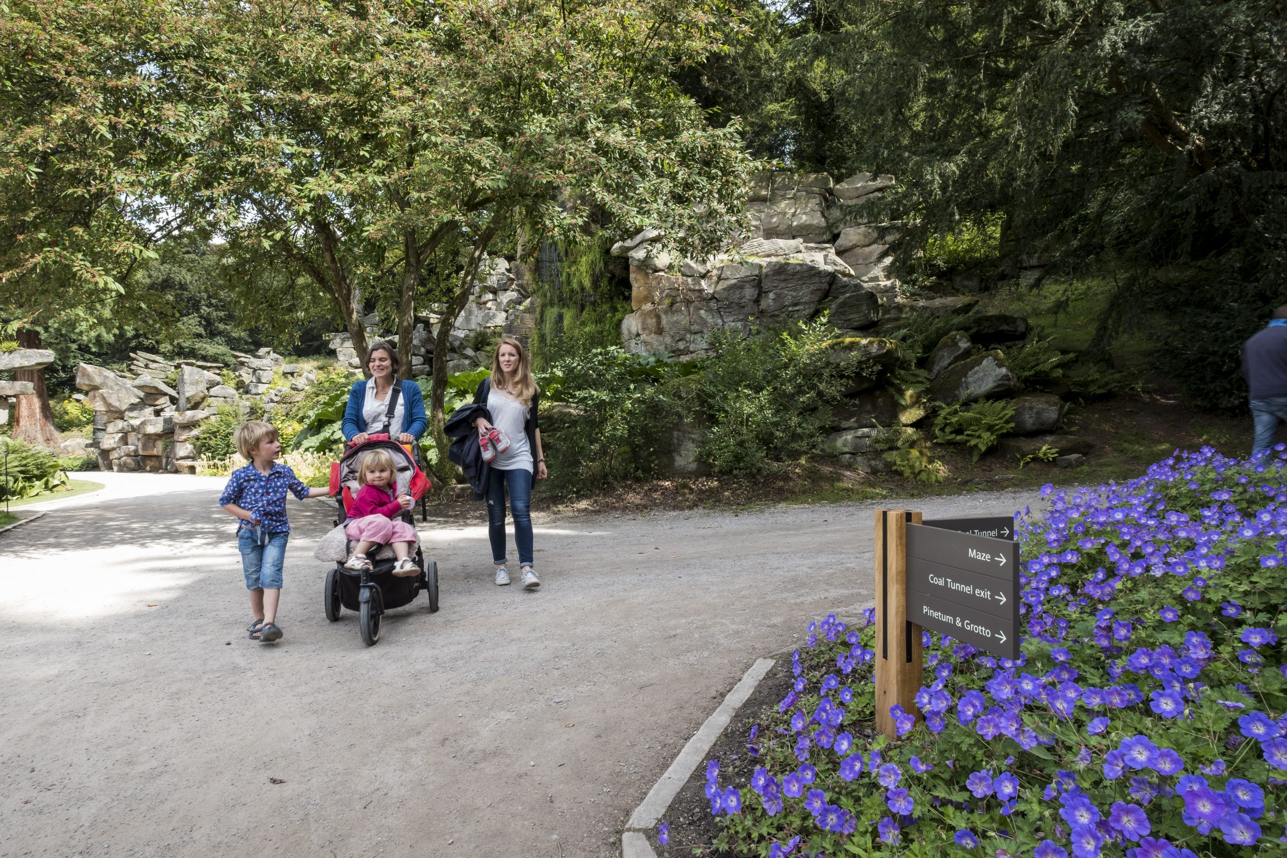 Outdoor view of family at Chatsworth enjoying the gardens (image features ABG Design signage in the foreground.